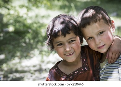 Hunza Valley, Pakistan. Jun 23, 2013 :  Portrait of an unidentified happy two children in the downtown of Karimabad, Hunza Valley.