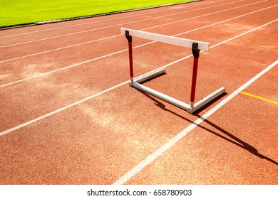 hurdle race barrier on red  running track , athletic stadium