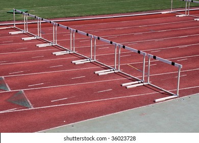 Hurdles in an empty track and field stadium