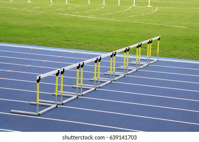 Hurdles on empty running track