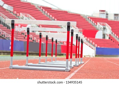 hurdles on the red running track prepared for competition.