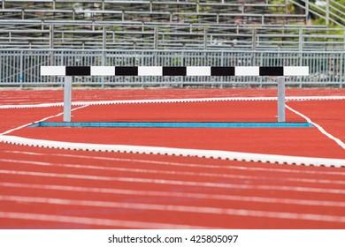 Hurdles on red running tracks