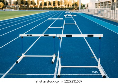 Hurdles on running track front view, nobody on it.