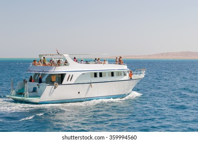 HURGADA, EGYPT - September 11, 2008. Tourists sailing on a yacht in the Red sea. Boat trip on bright sunny day.