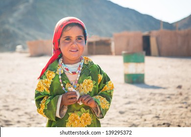 HURGHADA, EGYPT - APR 16, 2013: Unidentified bedouin people in the village on the desert near Hurghada, April 16, 2013. This Village is one of main tourist attractions on desert in Egypt.