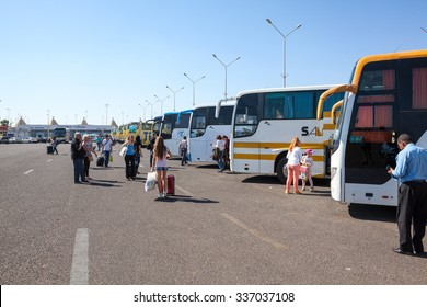 HURGHADA, EGYPT - CIRCA NOV, 2015: International Airport of Hughada with passenger busses are at the parking lot. Russian tourists transfer to hotels