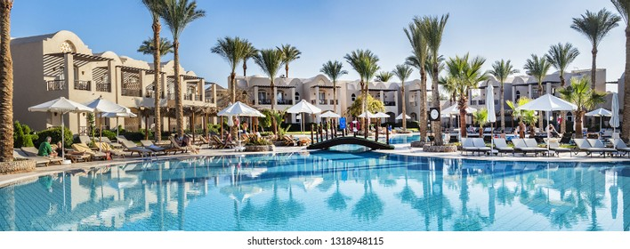 "HURGHADA, EGYPT - DECEMBER 16, 2018: ""Iberotel Makadi Beach"" is a premium, five-star holiday resort (313 guestrooms) in heart of ""Madinat Makadi"" Resort on Red Sea. Beautiful hotel area."