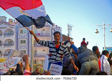 HURGHADA, EGYPT - FEBRUARY 02: Unidentified protesters demonstrate on the streets of Hurghada, Egypt on February 02, 2011. These are pro Mubarak demonstrators showing support for the Egyptian President