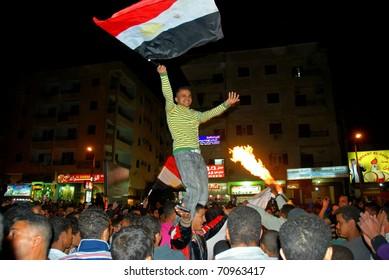 HURGHADA, EGYPT - FEBRUARY 11: People celebrate resignation of Hosni Mubarak from the position of President on February 11, 2011 in Hurghada, Egypt.