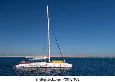 HURGHADA, EGYPT - FEBRUARY 12, 2016: Tourist sail boat  at Paradise Island.