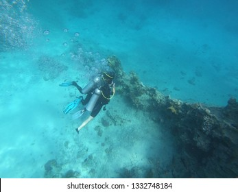 Hurghada Egypt - FEBRUARY 19, 2019: First time diver with instructor swimming in the Red Sea