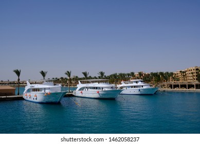 Hurghada / Egypt - May 21, 2019: Yachts and tourist boats in the Hurghada Marina. Hurghada is popular beach resort town along Red Sea coast of Egypt