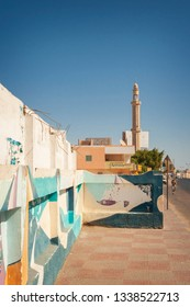 HURGHADA, EGYPT: OCTOBER 18, 2008. Main street of Hurghada town, with mosque minaret in background.