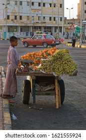 Hurghada, Red Sea / Egypt - 08.08.2017: Young boy selling fruits at street and earning income for the evening