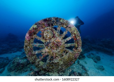 Hurghada, Red Sea / Egypt - 10.16.2019: Scuba diver modelling at the famous Thistelgorm ship wreck. She sunkt during war loaded with military supply.