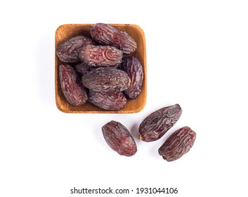 HURMA, Dates. Dried dates fruit with wooden plate on white background. Popular fruit of Ramadan.