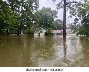 Hurricane Harvey 2017, flooding in North Hill Estates off East Cypresswood in Spring Texas, a couple miles north of Houston. Boat evacuation being carried out on flooded house in photo.