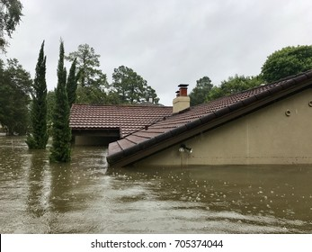 Hurricane Harvey 2017, flooding in Spring Texas a couple miles north of Houston off East Cypresswood  Drive. This house is almost completely submerged from the rain and rising bayou.