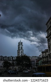 A hurricane is making its way on land in La Havana Cuba, creating a very oppressing scene with frightening lightening.