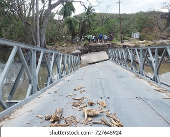 the Hurricane maria to everything destroyed during its passage on the island of the Dominica in the Caribbean here a gate broken. People can't go by car in their village. The 09/18/2017