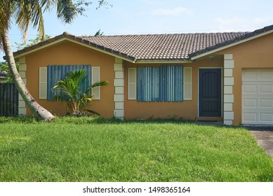 Hurricane Shutters on a Florida house. Storm panels cover the windows of a tropical home.