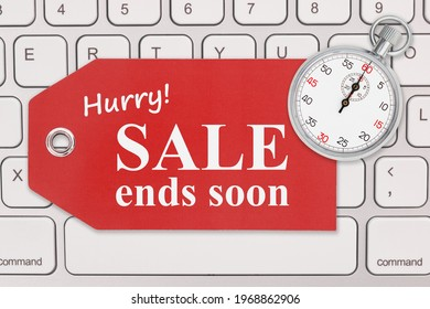 Hurry sale end soon message on a gift tag and stopwatch on gray keyboard for your online sales