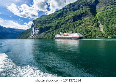 Hurtigruten cruise liner sailing on the Geirangerfjord, one of the most popular destination in Norway and UNESCO World Heritage Site. Geiranger, More og Romsdal, Norway, August 2018