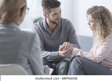 Husband apologizing to his wife during couple therapy