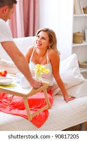 Husband bring breakfast to his pregnant wife