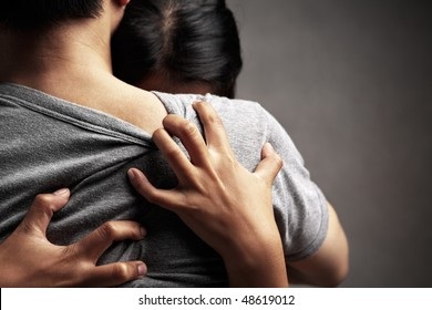 A husband embrace her sad wife, in dark background theme