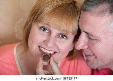Husband gives his wife a candy