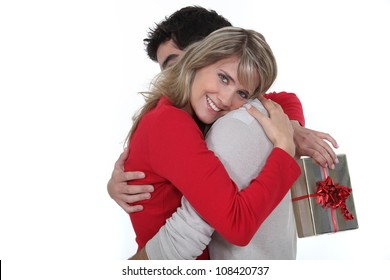 husband giving her wife a present