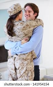 Husband Greeting Military Wife Home On Leave