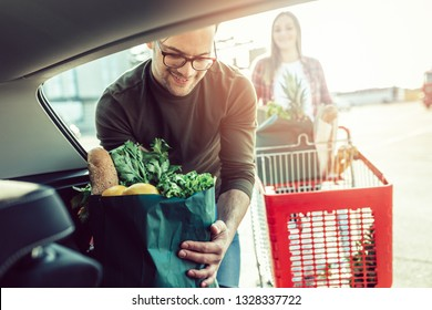 Husband and his wife after buying food in grocery store or supermarket.