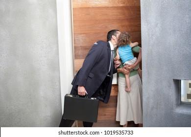 Husband kissing wife before work