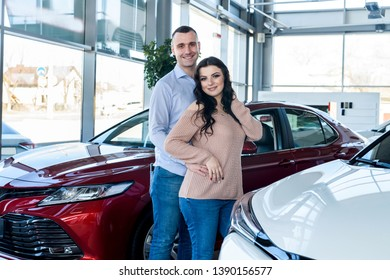 Husband making surprise to his wife in showroom