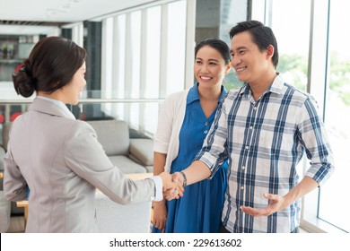 Husband shaking hands with the real estate agent
