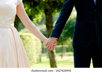Husband and wife hold hands together