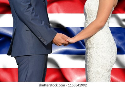 Husband and Wife holding hands - Conceptual photograph of marriage in Thailand