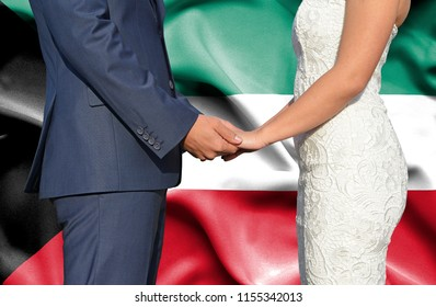 Husband and Wife holding hands - Conceptual photograph of marriage in Kuwait