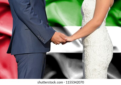 Husband and Wife holding hands - Conceptual photograph of marriage in United Arab Emirates