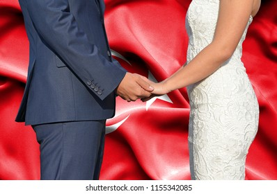 Husband and Wife holding hands - Conceptual photograph of marriage in Turkey