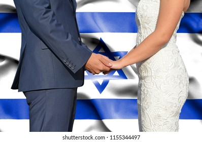 Husband and Wife holding hands - Conceptual photograph of marriage in Israel