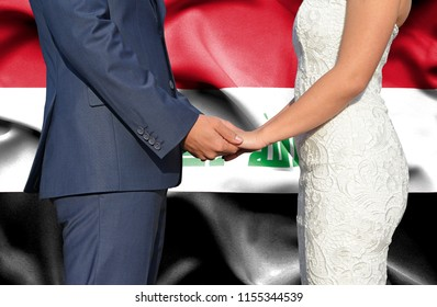 Husband and Wife holding hands - Conceptual photograph of marriage in Iraq