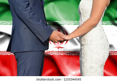 Husband and Wife holding hands - Conceptual photograph of marriage in Iran