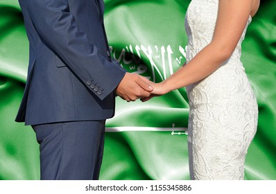 Husband and Wife holding hands - Conceptual photograph of marriage in Saudi Arabia