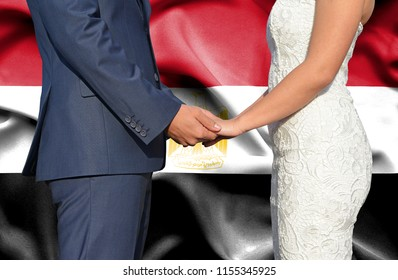 Husband and Wife holding hands - Conceptual photograph of marriage in Egypt