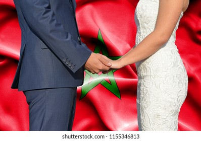 Husband and Wife holding hands - Conceptual photograph of marriage in Morocco