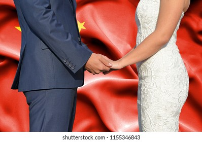 Husband and Wife holding hands - Conceptual photograph of marriage in China