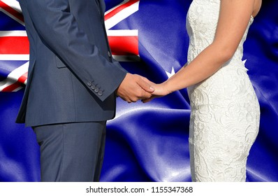 Husband and Wife holding hands - Conceptual photograph of marriage in Australia